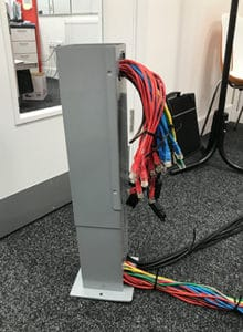 Gray Power Tower with Red and Blue Cables
